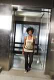 Walking out of elevator 03 Royalty Free Stock Image