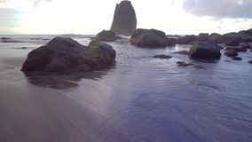 Walking over the Benijo beach ar the Tenerife stock footage