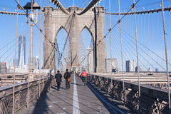 Walking over Brooklyn Bridge New York City Stock Image