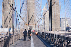 Walking over Brooklyn Bridge New York City royalty free stock photography