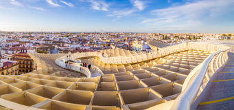 Walking over the mushroom. From the top of the Space Metropol Parasol (Setas de Sevilla) one have the best view of the city of Seville, Spain. It provides a Stock Photo