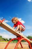Walking over seesaw. Happy little three years old boy child walking over seesaw keeping balance Stock Photos