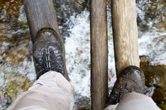 Walking over a swing bridge Royalty Free Stock Images