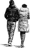 Walking pair Royalty Free Stock Image
