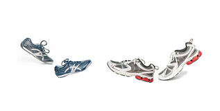 Walking pairs of sneakers Royalty Free Stock Photo