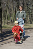 Walking in the park. Mother and doughter walking in the park Stock Photos