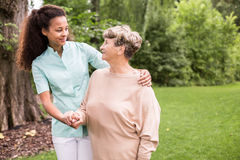 Walking in the park. Elder women and caregiver walking in the park Stock Photo