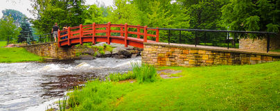 Red bridge in the park and woods. Stock Photo