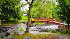 Red bridge in the park and woods. Stock Image