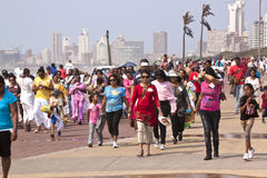 Walking Participants Celebrating Heritage Day in Durban South Af. DURBAN, SOUTH AFRICA - SEPTEMBER 24, 2014: National Heritage Day Walk participants walk along stock photos