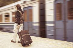 Walking passenger on a train station Royalty Free Stock Photos