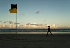 Walking past the swimming flag stock photography