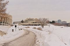 Walking path along Canadian history museum and surroundings on a cold winter day with snow. Walking path in a snow covered park next to the Canadian history royalty free stock photography