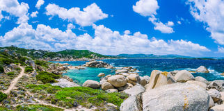 Walking path along sandstone rocksy coastline of Costa Serena, Sardinia, Italy Royalty Free Stock Photos
