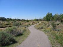 Walking Path along Santa Fe arroyo. A walking path along an arroyo in Santa Fe New Mexico Stock Photo