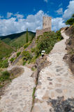 Walking path and La Tour Regine tower at Lastours Stock Photos