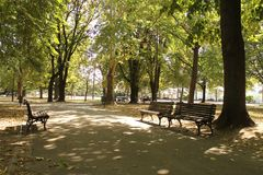 Kalemegdan Park in Fortess - old citadel in Belgrade, Serbia. Walking path with lanterns and trees on a sunny day at Kalemegdan park - old citadel in Belgrade royalty free stock photography