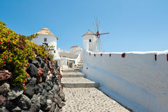Walking path leading to the Oia windmill on the island of Santorini (Thera). Cyclades islands,Greece. Royalty Free Stock Image