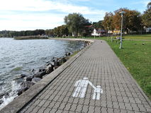 Walking path near water Stock Photo