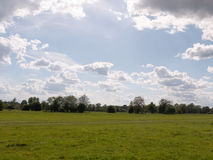 A walking path through an open countryside in the heartland of c. Onstable country essex england in the uk with no people and a clear sky on a summer afternoon Royalty Free Stock Photo