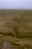 A walking path / road on a hill in the fog,  Pen y Fan peak, Brecon Beacons , Wales, UK. Brecon Beacons National is a Park in Monmouthshire, south east Wales Stock Photo