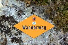 Walking path sign on rock. In Berner Oberland Switzerland, hiking path sign, wanderweg Stock Photos