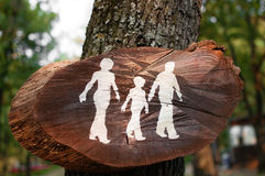 Walking path sign. Wooden walking path sign posted on a tree Royalty Free Stock Photos