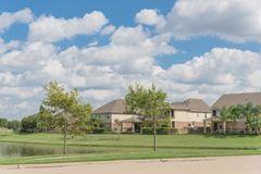 Residential houses by the lake in Pearland, Texas, USA stock image