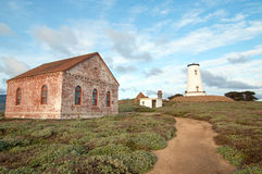 Walking pathway by Red Brick Fog Signal Building at the Piedras Blancas Lighthouse on the Central California Coast Royalty Free Stock Photos