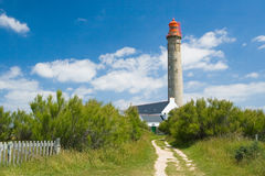 A walking pathway to the lighthouse. Stock Photos