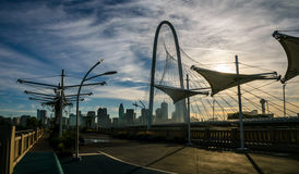 Walking on Pedestrian Bridge near Downtown Dallas Texas as the Sun beams sunrays over the Margaret Hunt Hill Bridge in the shade Stock Images