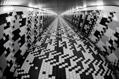 Walking in a pedestrian tunnel Stock Image