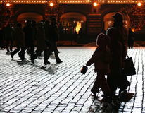 Walking people. At the night cobble-stone road (Red square, Moscow, Russia Stock Images