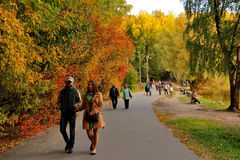 Walking people in autumn park Stock Photos