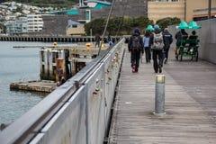 Walking people at the bay Royalty Free Stock Image