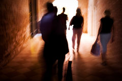 Walking people blurred motion Royalty Free Stock Image