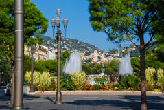Walking people bright beautiful streets of Nice Azure coast, France. stock photography