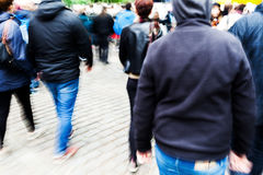 Walking people in the city in motion blur Stock Photo