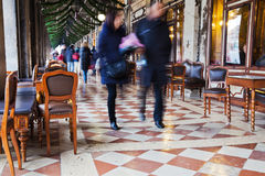 Walking people in colonnades in Venice Royalty Free Stock Photo