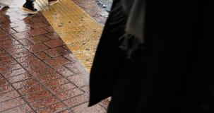 Walking people at Shibuya crossing in Tokyo rainy day. Walking people at the crossing in Tokyo rainy day. Shibuya-ku Tokyo Japan - 02.28.2019 : It is walking stock video