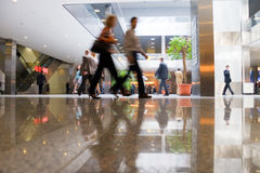 Walking people in modern business center stock photo