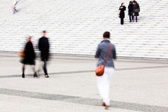 Walking people in motion blur Stock Images