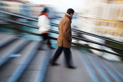 Walking people in motion blur Stock Image