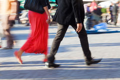Walking people in motion blur Royalty Free Stock Photos