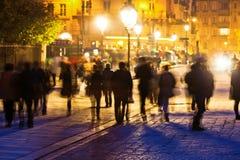 Walking people at night in Paris royalty free stock image