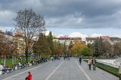 Walking people on park in front of National Palace of Culture in Sofia, Bulgaria. SOFIA, BULGARIA -NOVEMBER 12, 2017: Walking people on park in front of Stock Photo