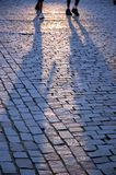 Walking people's shadows Royalty Free Stock Images