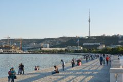 Walking people in seaside park, Baku Stock Photos