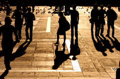 Walking people silhouette. Red sunset light Stock Image