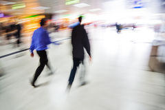 Walking people at a station Stock Image